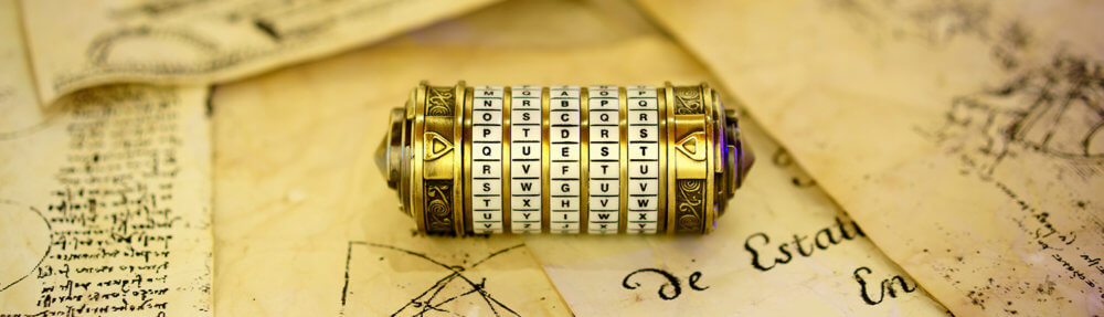Brass and ivory cylindrical cryptex on top of ancient notes written on yellow parchment